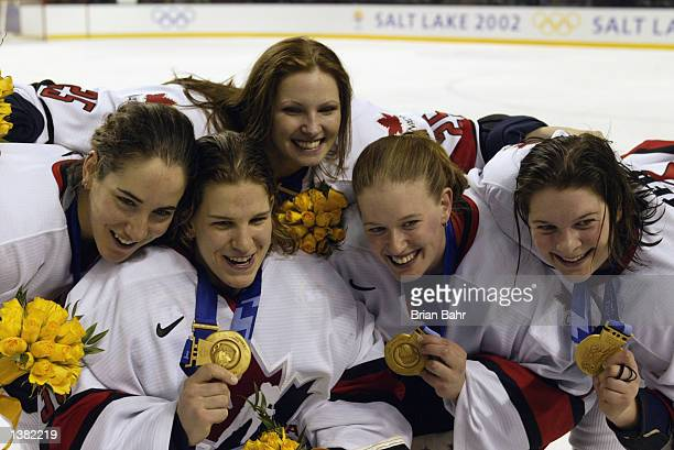 Canada shows off their gold medals after defeating the USA, 3-2, in the women's ice hockey gold medal game at the Salt Lake City Winter Olympics on...