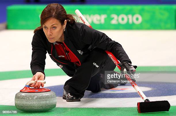 Canada skip Cheryl Bernard releases her stone down the sheet during the women's curling round robin game between Canada and Great Britain on day 12...