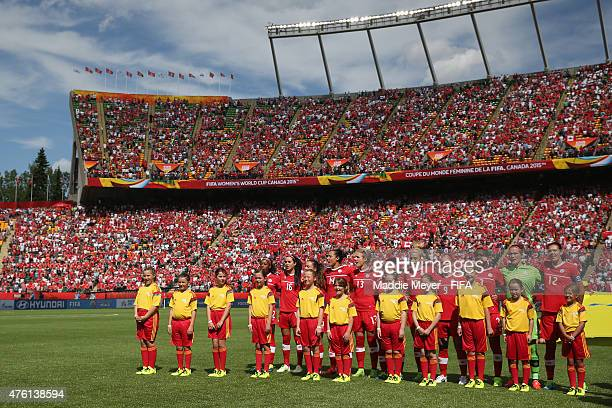 Canada stands for their national anthem before the FIFA Women's World Cup Canada 2015 Group A match between Canada and China PR at Commonwealth...