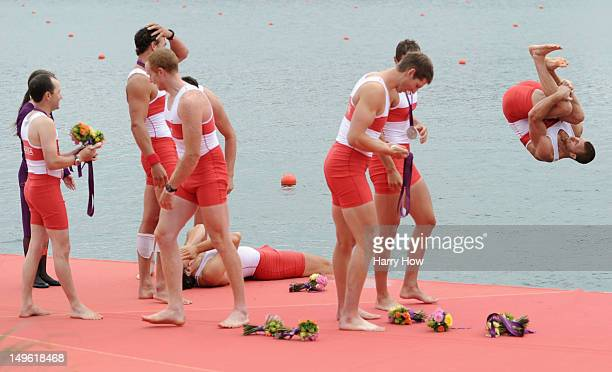Canada team member jumps into the water as his teammates celebrate winning silver in the Men's Eight Final on Day 5 of the London 2012 Olympic Games...