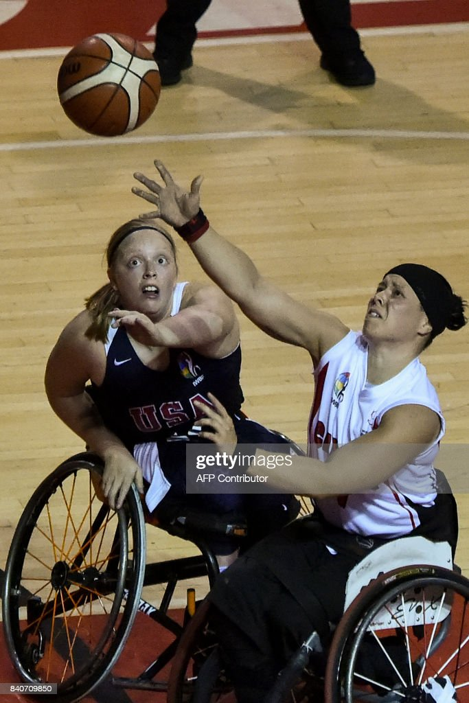 Canada team player Cindy Ouellet (R) vies for the ball with US team player Morgan Wood during their IWBF Women's American Cup of Wheelchair Basketball on August 29, 2017, in Cali, Colombia. The Canada team won the tournament, the United States team was second and Brazil team was third. ROBAYO