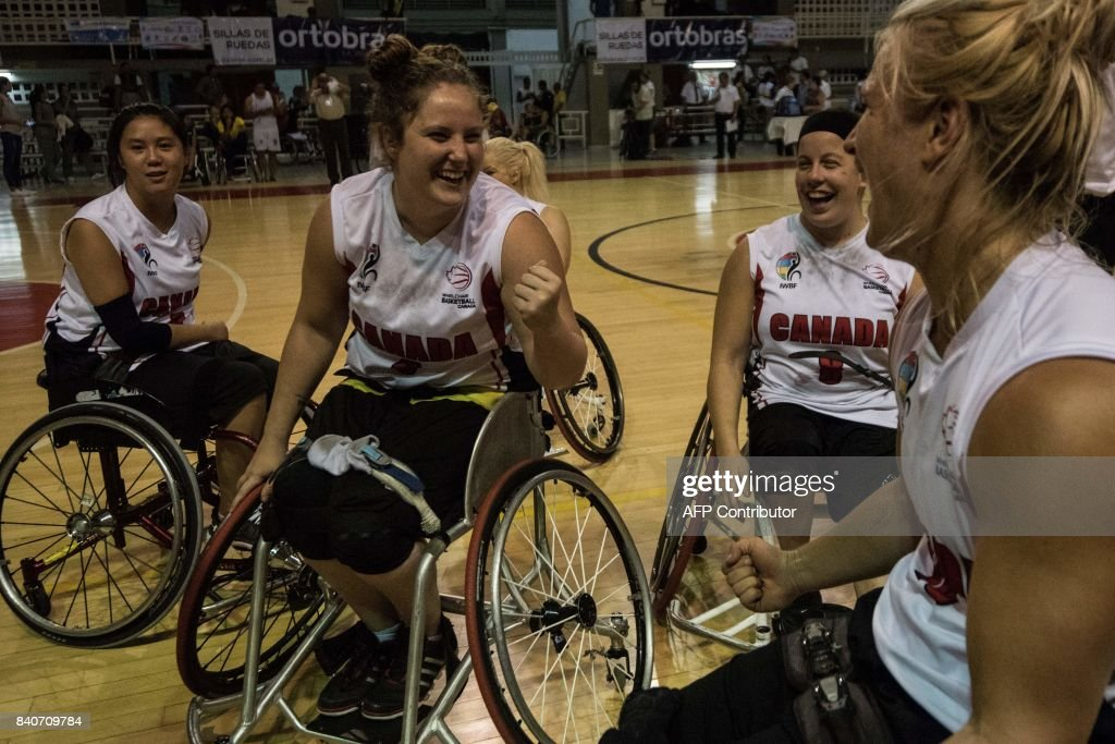 Canada team players celebrate after winning the first place in IWBF Women's American Cup of Wheelchair Basketball on August 29, 2017, in Cali, Colombia. The Canada team won the tournament, the United States team was second and Brazil team was third. ROBAYO