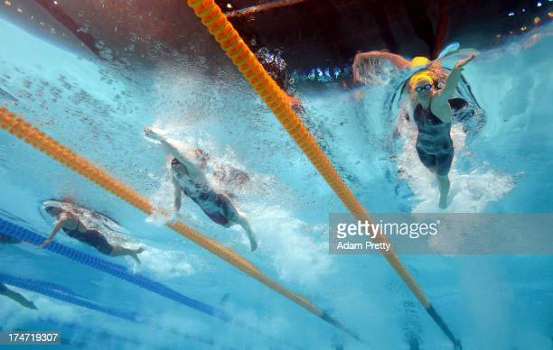 Canada USA and Australia compete during the Swimming Women's 4 x 100m Freestyle final on day nine of the 15th FINA World Championships at Palau Sant...