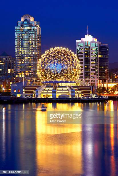 canada, vancouver, illuminated telusphere at science centre reflecting in water - vancouver canada stock pictures, royalty-free photos & images