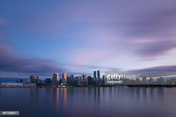 Canada, Vancouver, view to skyline at dusk seen from Stanley Park