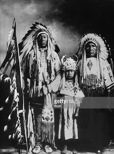 Canada White head Iroquois chief of the tribe of the black Feet holding in his right hand the stick of the war dance and in the other his tobacco...