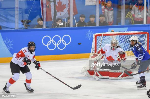 Canada Women's Hockey defender Renata Fast and US Women's Hockey forward Brianna Decker from Dousman WI watch a long shot go between them as Canada...