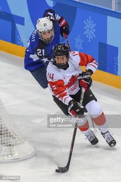 Canada Women's Hockey defender Renata Fast brings the puck from behind the goal as US Women's Hockey forward Hilary Knight from Sun Valley ID gives...