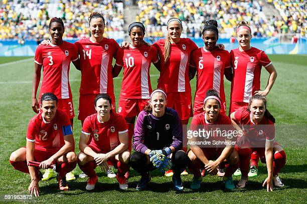 Canadaian team line up for their national anthem before the Women's Olympic Football Bronze Medal match between Brazil and Canada at Arena...