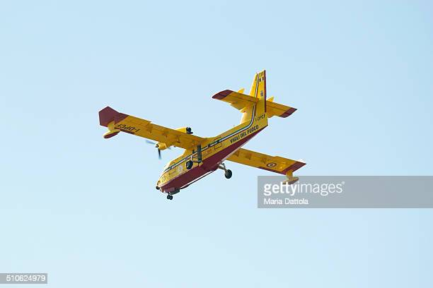Canadair CL-415 23 air vehicle of firefighters coming in to land after operation of turning off fire in Calabria