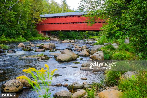 canada-quebec-baie-saint-paul-saint-placide covered bridge - brook mitchell stock pictures, royalty-free photos & images