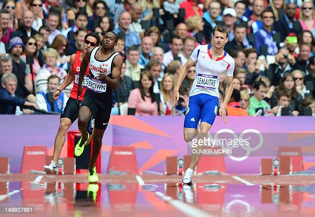Canada's Aaron Brown and France's Christophe Lemaitre compete in the men's 200m heats at the athletics event during the London 2012 Olympic Games on...