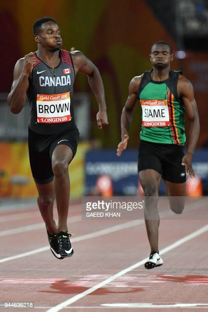 Canada's Aaron Brown and Zambia's Sydney Siame compete in the athletics men's 200m semifinal during the 2018 Gold Coast Commonwealth Games at the...