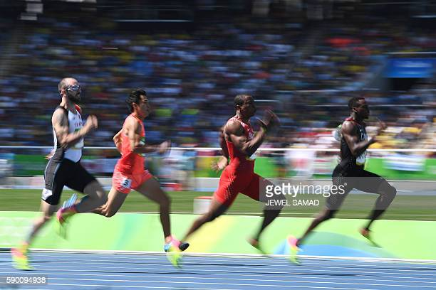 Canada's Aaron Brown Bahrain's Yaqoob Salem Eid Yaqoob Japan's Shota Iizuka and Turkey's Ramil Guliyev compete in the Men's 200m Round 1 during the...