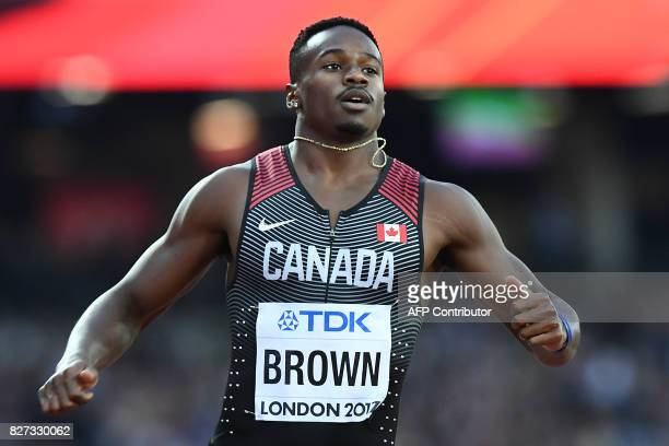 Canada's Aaron Brown competes in the heats of the men's 200m athletics event at the 2017 IAAF World Championships at the London Stadium in London on...