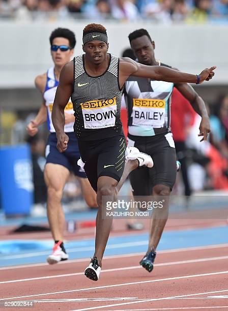 Canada's Aaron Brown crosses the finish line in the men's 200 metres athletics event during the Seiko Golden Grand Prix at Todoroki Stadium in...