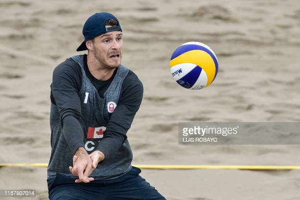 Canada's Aaron Nusbaum eyes the ball during a Lima 2019 PanAmerican Games men's beach volleyball match against Nicaragua at the Beach Volleyball...