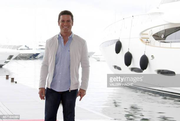 Canada's actor Yannick Bisson waves as he poses during a photocall for the TV serie Murdoch mysteries as part of the MIPCOM on October 13 2014 in...