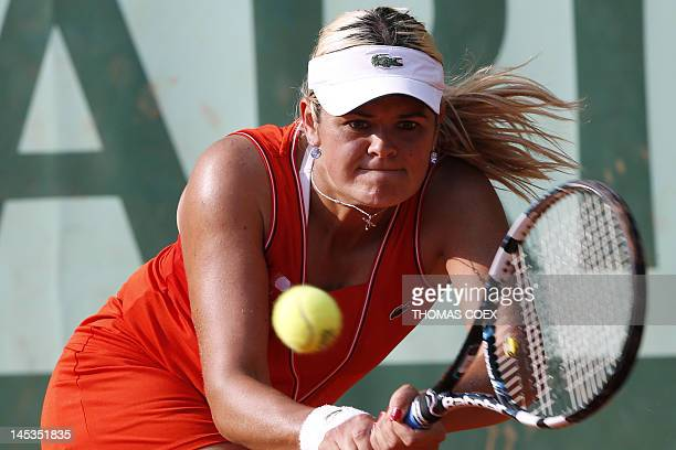 Canada's Aleksandra Wozniak hits a return to Canada's Heidi El Tabakh during their women's Singles 1st Round tennis match of the French Open tennis...