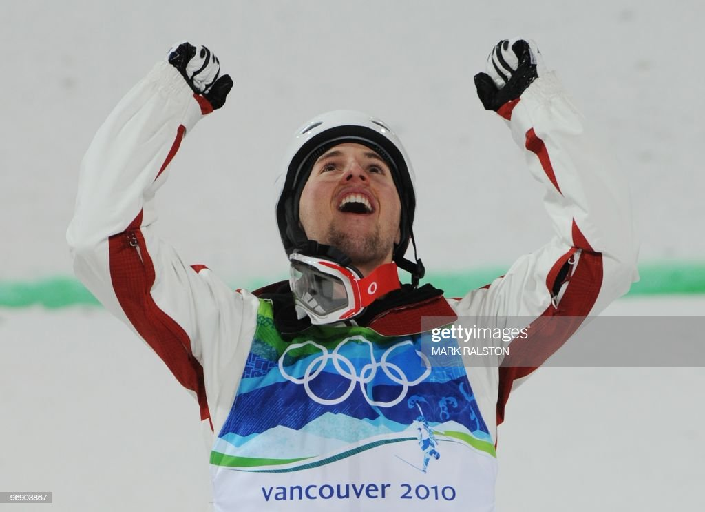 Canada's Alexandre Bilodeau celebrates after winning the Men's Freestyle Skiing Moguls event at Cypress Mountain during the Vancouver Winter Olympics on February 14, 2010. AFP PHOTO/Mark RALSTON