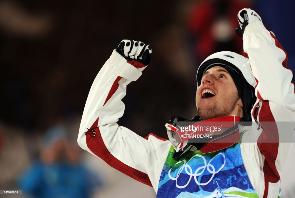 Canada's Alexandre Bilodeau celebrates during the Men's Moguls Freestyle Skiing final at Cypress Mountain during the Vancouver Winter Olympics, north of Vancouver on February 14, 2010. Bilodeau won the gold medal.