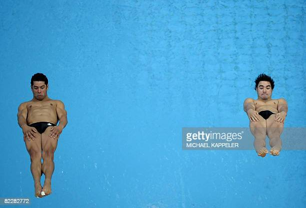 Canada's Alexandre Despatie and Arturo Miranda compete during the men's synchronised 3m springboard final at the National Aquatics Center in the 2008...