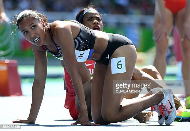 Canada's Alicia Brown looks on after competing in the Women's 400m Round 1 during the athletics event at the Rio 2016 Olympic Games at the Olympic...