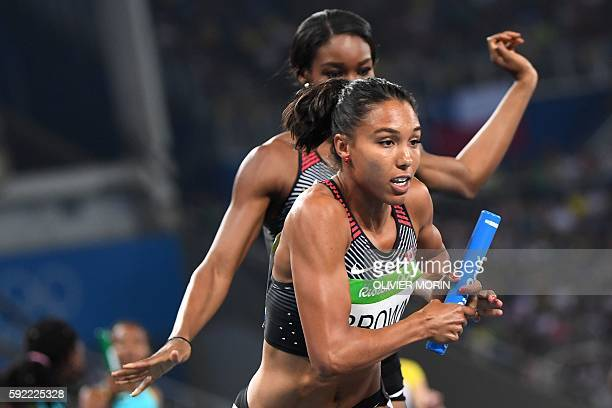 Canada's Alicia Brown runs with the baton in the Women's 4x400m Relay Round 1 during the athletics event at the Rio 2016 Olympic Games at the Olympic...