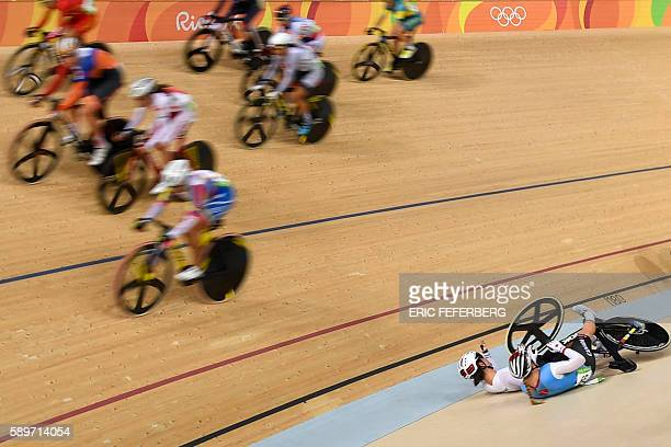 TOPSHOT Canada's Allison Beveridge and Germany's Anna Knauer fall during the Women's Omnium Scratch race track cycling event at the Velodrome during...