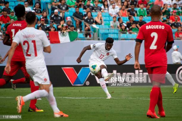Canada's Alphonso Davies takes a shot during their CONCACAF Gold Cup group stage football match against Cuba at Bank of America Stadium in Charlotte...
