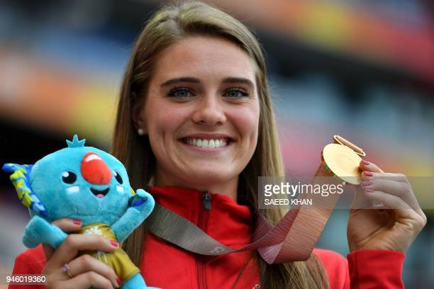 Canadas Alysha Newman poses with her gold medal during the medal ceremony for the athletics women's pole vault during the 2018 Gold Coast...