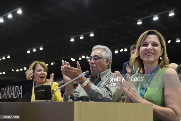 Canadas ambassador to the United Nations Educational Scientific and Cultural Organisation Elaine Ayotte is seen celebrating with members of the...