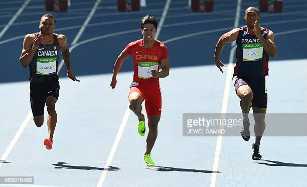 Canada's Andre De Grasse China's Su Bingtian and France's Jimmy Vicaut compete in the Men's 100m Round 1 during the athletics event at the Rio 2016...