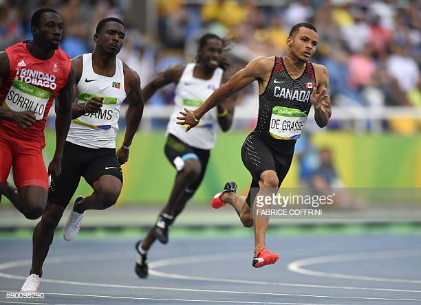Canada's Andre De Grasse competes in the Men's 200m Round 1 during the athletics event at the Rio 2016 Olympic Games at the Olympic Stadium in Rio de...