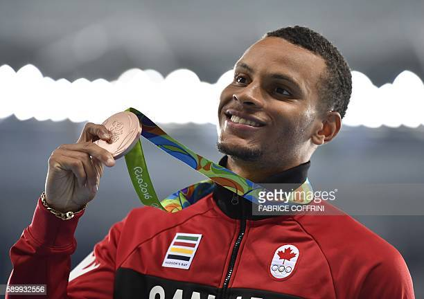 Canada's Andre de Grasse poses during the podium ceremony for the men's 100m during the athletics event at the Rio 2016 Olympic Games at the Olympic...