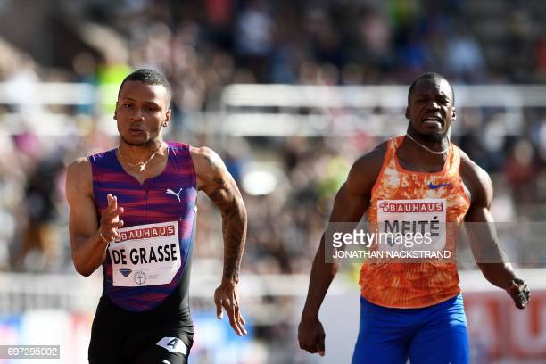 Canadas Andre De Grasse wins the men's 100m event ahead of Ivory Coasts Ben Youssef Meite during the IAAF Diamond League athletics competition in...