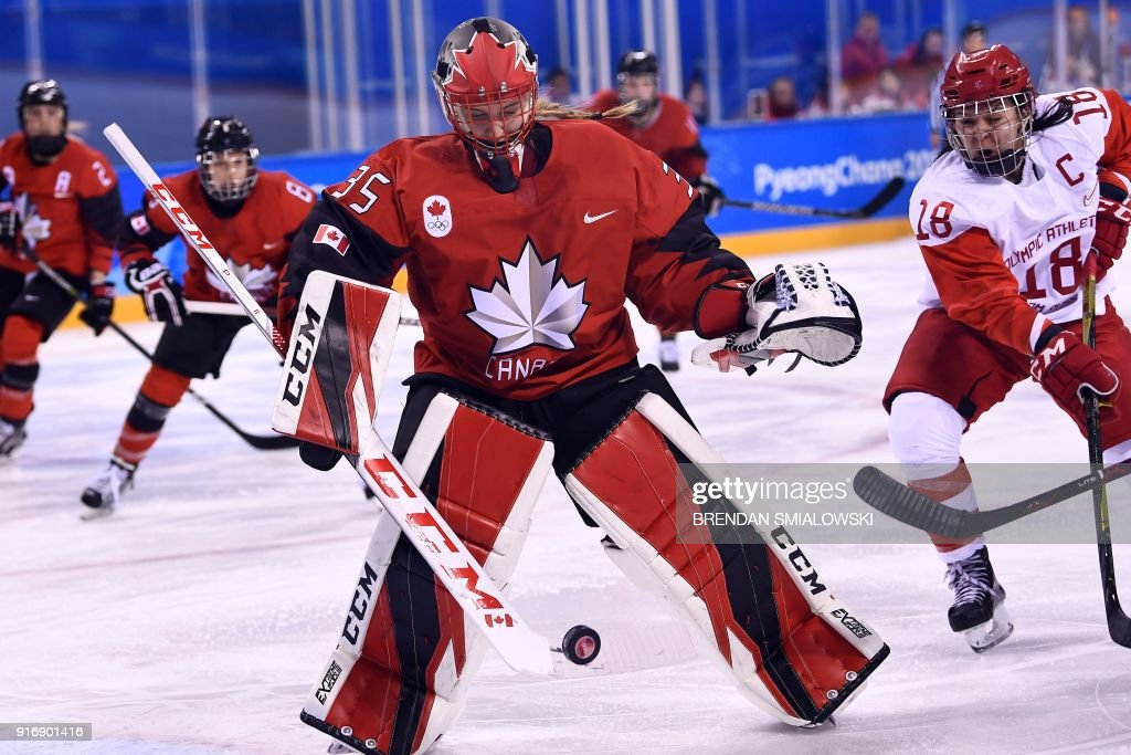 TOPSHOT - Canada's Ann-Renee Desbiens blocks a puck in the women's preliminary round ice hockey match between Canada and the Olympic Athletes from Russia during the Pyeongchang 2018 Winter Olympic Games at the Kwandong Hockey Centre in Gangneung on February 11, 2018. / AFP PHOTO / Brendan Smialowski