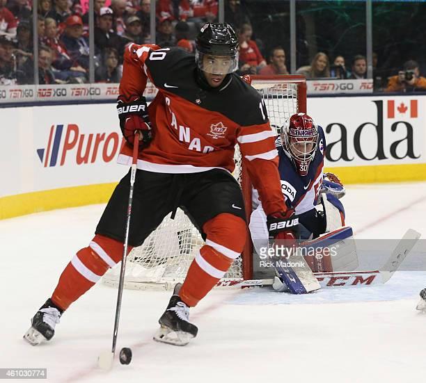 TORONTO JANUARY 4 Canada's Anthony Duclair circles around the net and goalie Denis Godla 2015 IIHF World Junior Championship hockey 2nd period Semi...