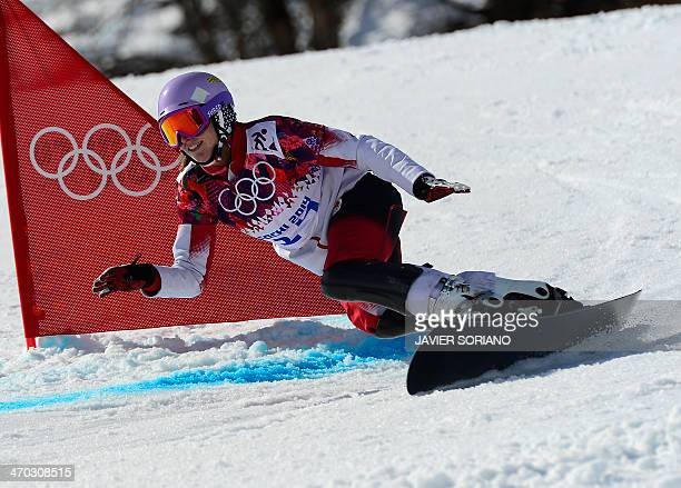 Canada's Ariane Lavigne competes in the Women's Snowboard Parallel Giant Slalom 1/8 Finals at the Rosa Khutor Extreme Park during the Sochi Winter...