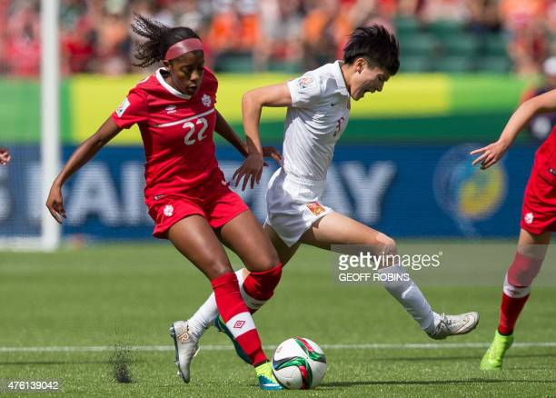 Canada's Ashley Lawrence vies with China's Wu Haiyan during a Group A football match between Canada and China at Commonwealth Stadium during the...