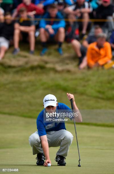 Canada's Austin Connelly places his ball on the 7th green during his final round on day four of the 2017 Open Golf Championship at Royal Birkdale...