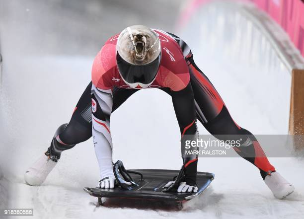 Canada's Barrett Martineau slows down at the end of the mens's skeleton heat 2 during the Pyeongchang 2018 Winter Olympic Games at the Olympic...