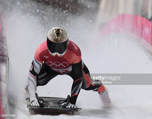 Canada's Barrett Martineau slows down at the end of the mens's skeleton heat 3 run during the Pyeongchang 2018 Winter Olympic Games at the Olympic...