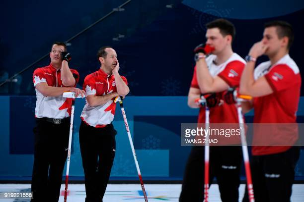 Canada's Ben Hebert and Brent Laing look on during the curling men's round robin session between Canada and Sweden during the Pyeongchang 2018 Winter...