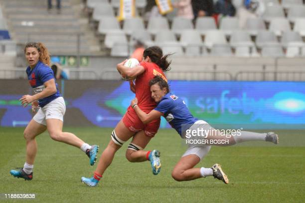 Canada's Bianca Farella is tackled by France's Shannon Izar during the HSBC World Rugby Sevens Series women's rugby match between Canada and France...