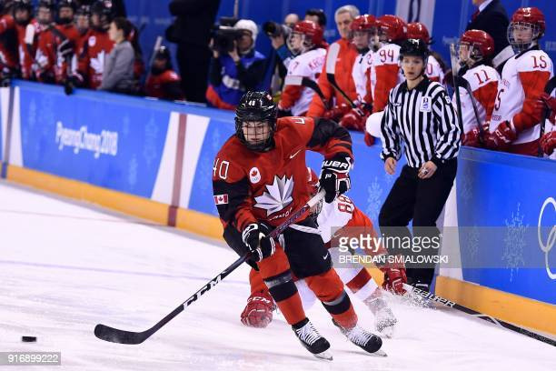 Canada's Blayre Turnbull controls the puck in the women's preliminary round ice hockey match between Canada and the Olympic Athletes from Russia...