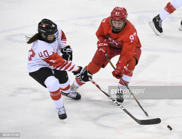 Canada's Blayre Turnbull vies with Russia's Anna Shokhina in the women's semifinal ice hockey match between Canada and the Olympic Athletes from...