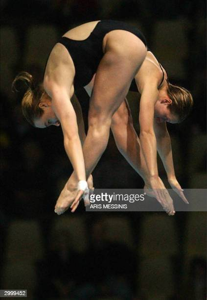 Canada's Blythe Hartley and Emilie Heymans dive in the final of the 10 meter synchronised plattform in the 14th Diving World Cup in Athens Olympic...