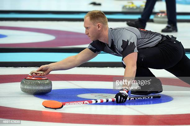 Canada's Brad Jacobs the stone during the Men's Curling Round Robin Session 6 between Canada and Denmark at the Ice Cube Curling Center during the...