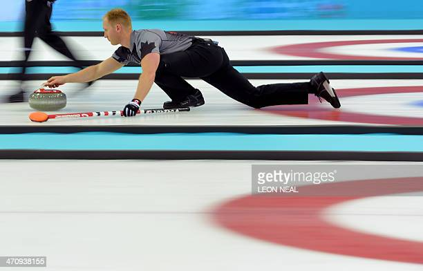 Canada's Brad Jacobs throws the stone during the Men's Curling Gold Medal Game between Canada and Great Britain at the Ice Cube Curling Center in...